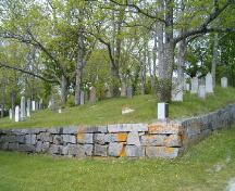 View of granite wall surrounding part of cemetery, Old Kirk Burying Ground, Shelburne, 2004.; Heritage Division, NS Dept. of Tourism, Culture and Heritage, 2004