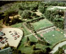 Aerial view of central ornamental grounds of the former Indian Head Nursery Station, now the PFRA Shelterbelt Centre, showing site of demolished superintendent's residence, 1985.; Centre Shelterbelt ARAP / PFRA Shelterbelt Centre, 1985.