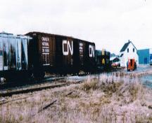 View of a train pulling into the station (seen at the right of the photo). Picture taken circa 1980s.; HFNL 2007