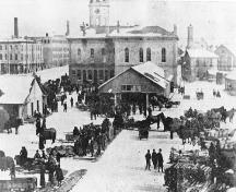 View of east side of market pavillion and town hall showing 1875 addition on back -1896; Guelph Public Library