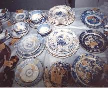 Plates, saucers and tea cups excavated from privy; OHT