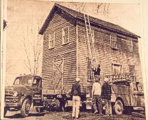 Historic image of the house being relocated by owner Jack Thompson - 1964; Jack Thomson, 1964