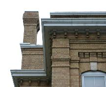 View of the cornice and brickwork detail on the Brandon Court House, Brandon, 2005; Historic Resources Branch, Manitoba Culture, Heritage, Tourism and Sport, 2005