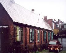 View of the south elevation of the rear hall showing buttresses and windows – November 2001; OHT, 2001