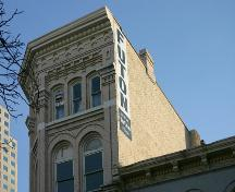 Detail view of the roofline of the Telegram Building, Winnipeg, 2005; Historic Resources Branch, Manitoba Culture, Heritage and Tourism 2005