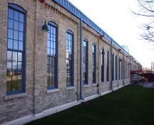View of the northwest elevation of the Northern Pacific and Manitoba Railway Repair Shop, Winnipeg, 2005; Historic Resources Branch, Manitoba Culture, Heritage and Tourism, 2005