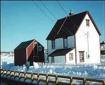 Rear view of Adam Mouland House, Bonavista, showing its linhay and the fish store on the property, circa winter of 1998.; HFNL 1998