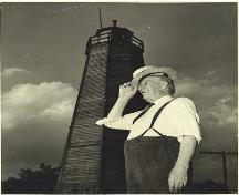 John Sutherland standing in front of the Port Burwell Lighthouse; Port Burwell Marine Museum, Museums of Bayham