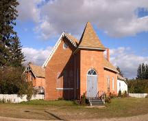 Contextual view, from the southwest, of the Sidney Church and Manse, Sidney, 2005; Historic Resources Branch, Manitoba Culture, Heritage and Tourism 2005