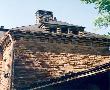 Detail view of stone ornamentation on the building's east elevation – July 2003; OHT, 2003