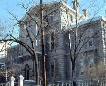 A stern, Italianate-style structure, built of grey Gloucester limestone from 1870-1871; City of Ottawa 2005