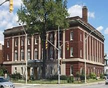 The 3-storey Neo-Classical Revival style red brick Masonic Temple features fluted stone pilasters.; City of Windsor, Nancy Morand