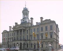 Corner view of the Victoria Hall / Cobourg Town Hall, showing the front elevation and the central, temple-fronted pavilion, 1990.; Parks Canada Agency / Agence Parcs Canada, 1990.