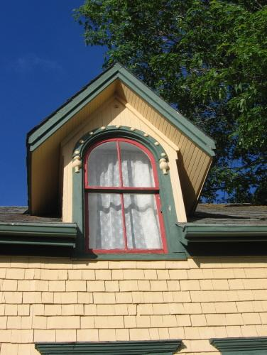 Showing detail of round arch dormer window