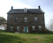 Rear elevation, Peter Smyth House, Port Hood, NS, 2002. This entrance would have originally be used by servants, leading to their quarters.; Inverness County Heritage Advisory Committee, 2002