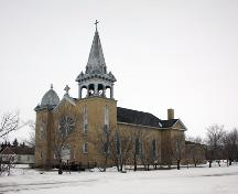 View of main elevations, from the southeast, of the Sacred Heart of Jesus Roman Catholic Church, Fannystelle, 2005; Historic Resources Branch, Manitoba Culture, Heritage, Tourism and Sport, 2005