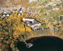 Aerial view of Glynmill Inn, shown in its environmental setting. Note the forested area and Glynmill Inn Pond at the rear of the photo.; HFNL 2008