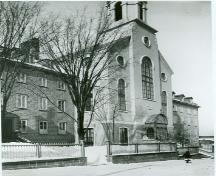 Corner view of the Bon-Pasteur Chapel, showing the Bon-Pasteur wing on the left and the Marie-Fitzbach wing on right, as seen ca. 1880.; Library and Archives Canada/ Bibliothèque et Archives Canada, PA 23915, ca. 1880.