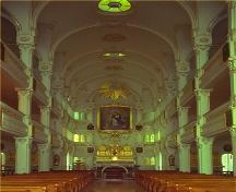 Central view of the interior of the Bon-Pasteur Chapel, 1980.; Parks Canada Agency/ Agence Parcs Canada, 1980.