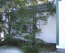 View of rear ell (blocked by trees) Everett Smith House, Barrington Passage, NS, 2007.; Department of Tourism, Heritage and Culture, Province of Nova Scotia 2007