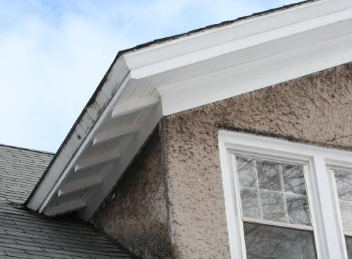 Showing detail of dormer with stucco wall