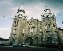 View of the main (north) façade of St. Brigid's Church showing the two towers – 2004; OHT, 2004
