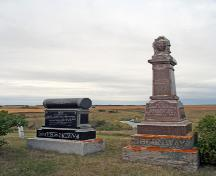 View, from the east, of the Thomas Greenway Cemetery, Crystal City, 2006. These stones mark the graves of two sons of Thomas Greenway, Harry and Thomas A.; Historic Resources Branch, Manitoba Culture, Heritage and Tourism, 2006