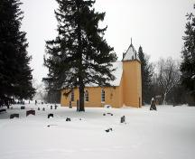 Contextual view, from the northwest, of St. Anne's Anglican Church, Poplar Point area, 2005; Historic Resources Branch, Manitoba Culture, Heritage and Tourism 2005