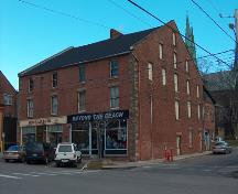 Showing window placement, brickwork, quoins, and raised parapet gable ends; City of Charlottetown, John Boylan, 2004