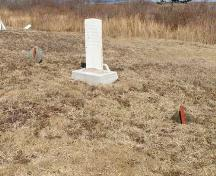A grave marker in its new base at Founders Cemetery, Beaver River, Yarmouth County, NS, 2008. These new bases are individually made to suit each marker.; Heritage Division, NS Dept. of Tourism, Culture & Heritage, 2008.
