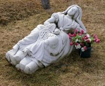 "The ""Marble Lady"" in Chebogue Cemetery, Rockville, Yarmouth County, NS, 2008. The monument was commissioned by Dr. Frederick Webster for his wife Margaret MacNaught Webster.; Heritage Division, NS Dept. of Tourism, Culture and Heritage, 2008"