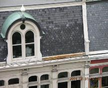Detail showing fourth level dormer window, inset into mansard slate roof.; OHT, 2004