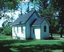 Front view of Christ Anglican Church.; Government of Saskatchewan, Frank Korvemaker, 1986