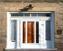 Main Entrance which displays recessed sidelights and a decorated transom, 2002.; Department of Planning, City of Brantford, 2002.