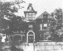 Allison House front facade showing original tower and porch, late 19th century.; Queen's University Archives