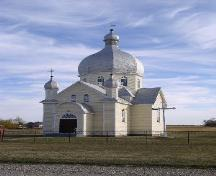 Front view of the St. John the Baptist Ukrainian Greek Catholic Church featuring the onion-shaped dome, 2003.; Government of Saskatchewan, J. Bisson, 2003