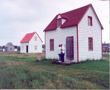 Contextual view of the building showing the McLeod House in between two other HBC houses – c. 1993; OHT, 1993