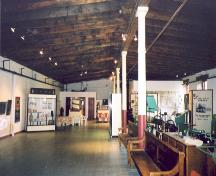 View of the interior of  the warehouse showing the wooden beams and support columns – 2003; OHT, 2003