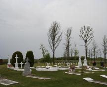 Contextual view, from the southeast, showing the main cemetery in the foreground and in the background the recently recovered 1902 section of the Overstoneville Independent Cemetery, Tolstoi area, 2006; Historic Resources Branch, Manitoba Culture, Heritage and Tourism, 2006