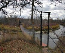 Contextual view, from the east, of the Senkiw School Suspension Bridge, Roseau River area, 2006; Historic Resources Branch, Manitoba Culture, Heritage and Tourism, 2006