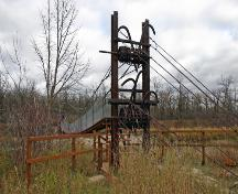 Detail view of the main tower, from the northwest, of the Senkiw School Suspension Bridge, Roseau River area, 2006; Historic Resources Branch, Manitoba Culture, Heritage and Tourism, 2006