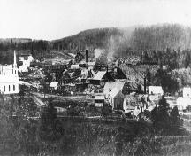 Image of the mines and the surrounding community during the period of albertite extraction.; Albert County Museum