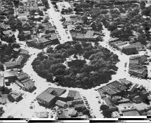 An aerial view of the Square, looking west, most closely aligned with East and West Streets.; Gordon Henderson, July 1950