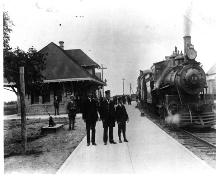 The station chief in front of the Shediac Railway Station. ; CÉA P223-A238