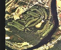 Aerial photo of the Fraser Edmundston Golf Club in which we see the entire 18 hole course.; City of Edmundston