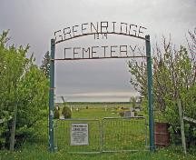 Contextual view, from the west, of the main gate of Green Ridge Cemetery, Dominion City area, 2006; Historic Resources Branch, Manitoba Culture, Heritage, Tourism and Sport, 2006