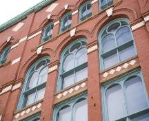 This image shows the upper storeys of the front façade of the building.; Commercial Properties Limited