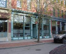 View of the building's storefront.; Commercial Properties Limited