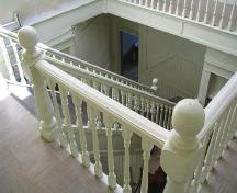 View of the staircase in the Burchill and Howey Block, Brandon, 2005; Historic Resources Branch, Manitoba Culture, Heritage, Tourism and Sport, 2005
