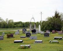 Contextual view, from the southeast, of the cemetery grounds and gate at the Fredensthal Lutheran Cemetery section of the Fredensthal Lutheran Cemeteries, Emerson area, 2007; Historic Resources Branch, Manitoba Culture, Heritage, Tourism and Sport, 2007